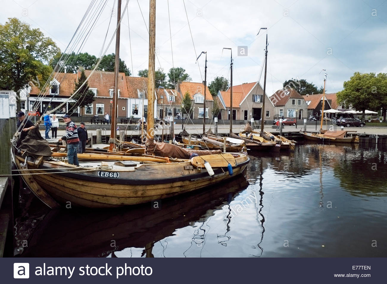 Classic wooden boats are moored in the harbor of the small city of Elburg, in the Netherlands. - Stock Image
