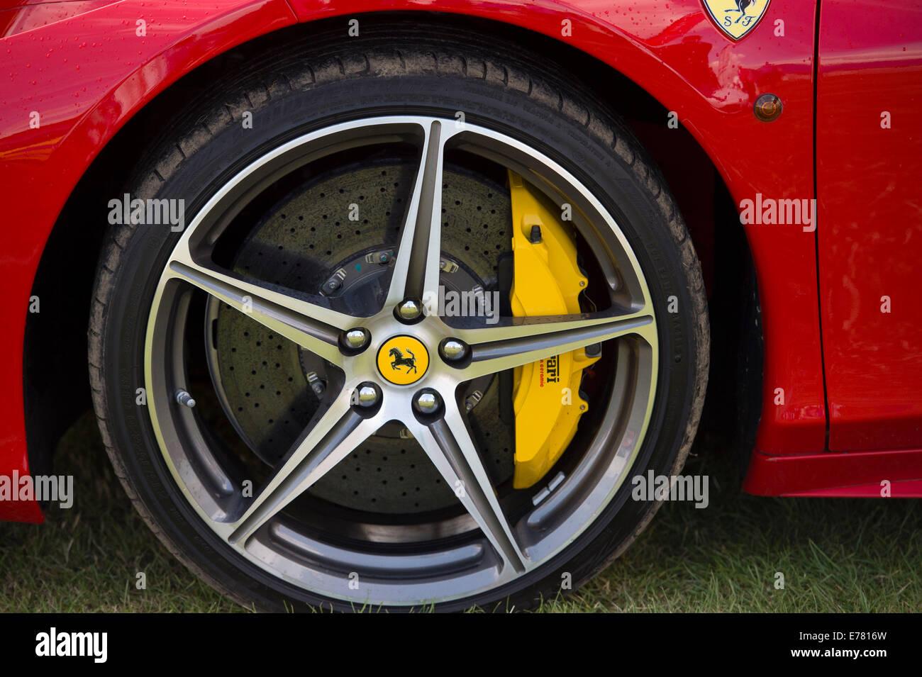 Ferrari wheels on a red Ferrari car. - Stock Image