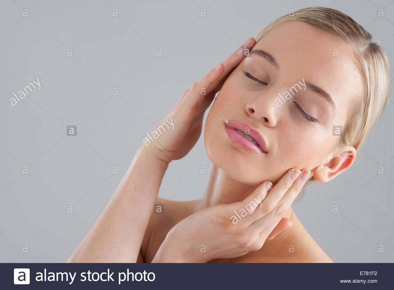 Portrait of woman with eyes closed - Stock Image
