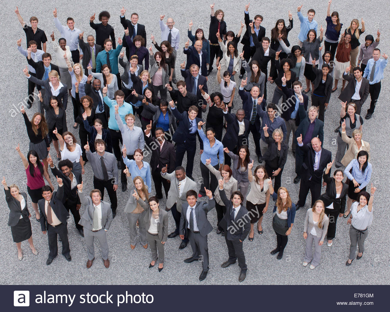 Portrait of smiling and gesturing crowd - Stock Image