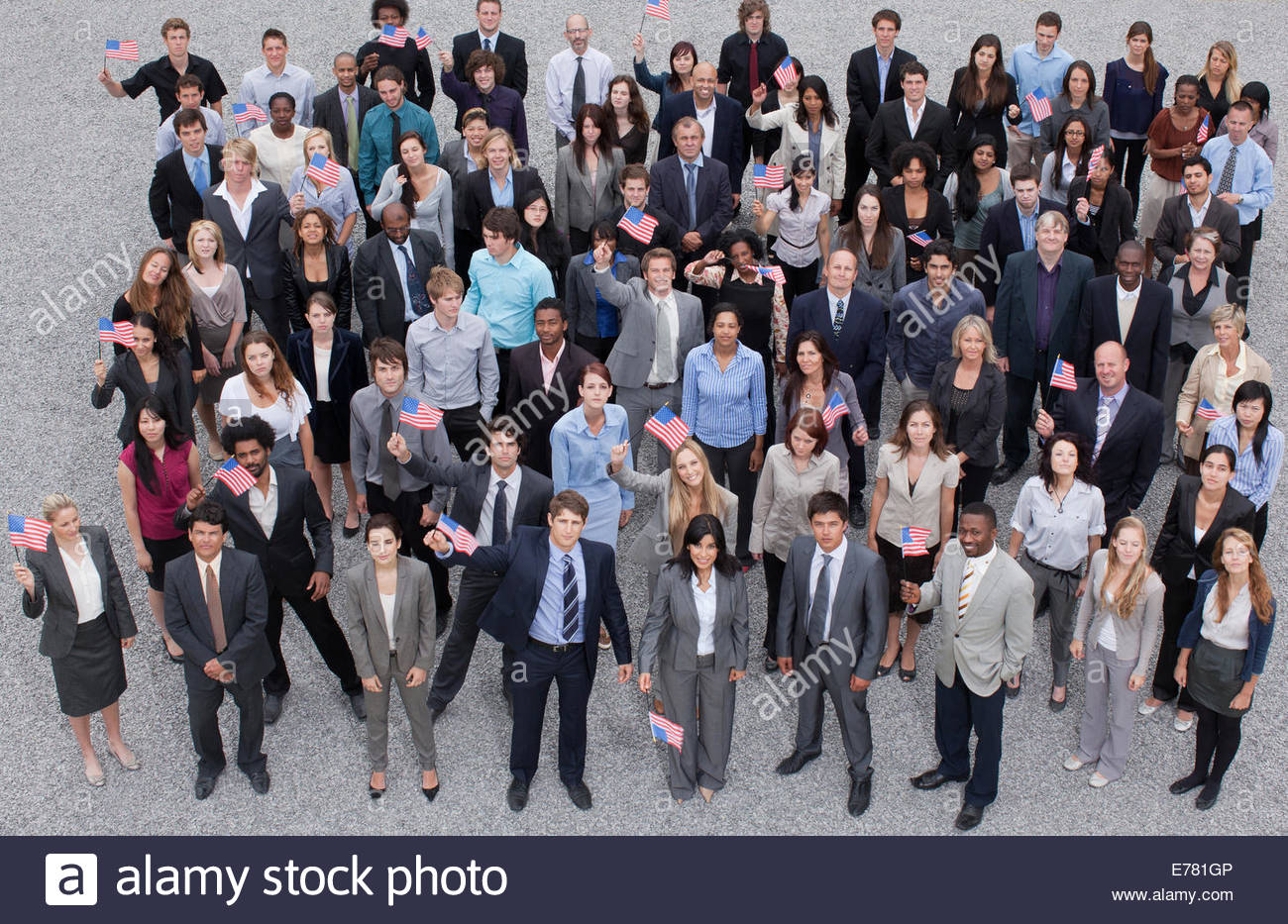 Portrait of cheering crowd of business people - Stock Image
