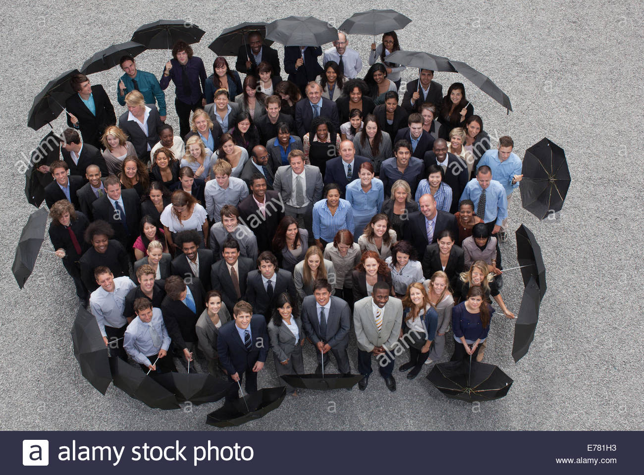 Business people with umbrellas - Stock Image