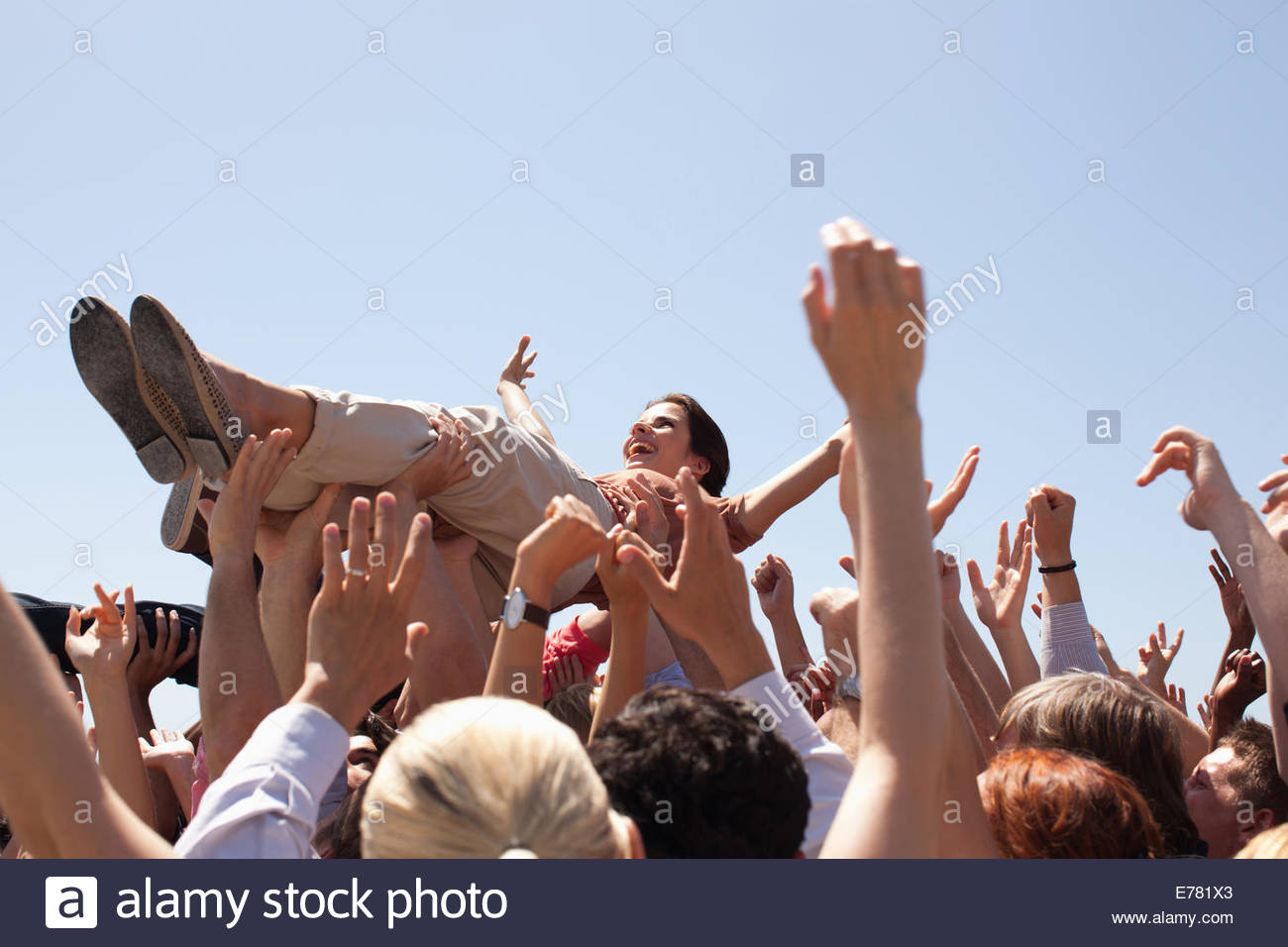 Woman crowd surfing - Stock Image