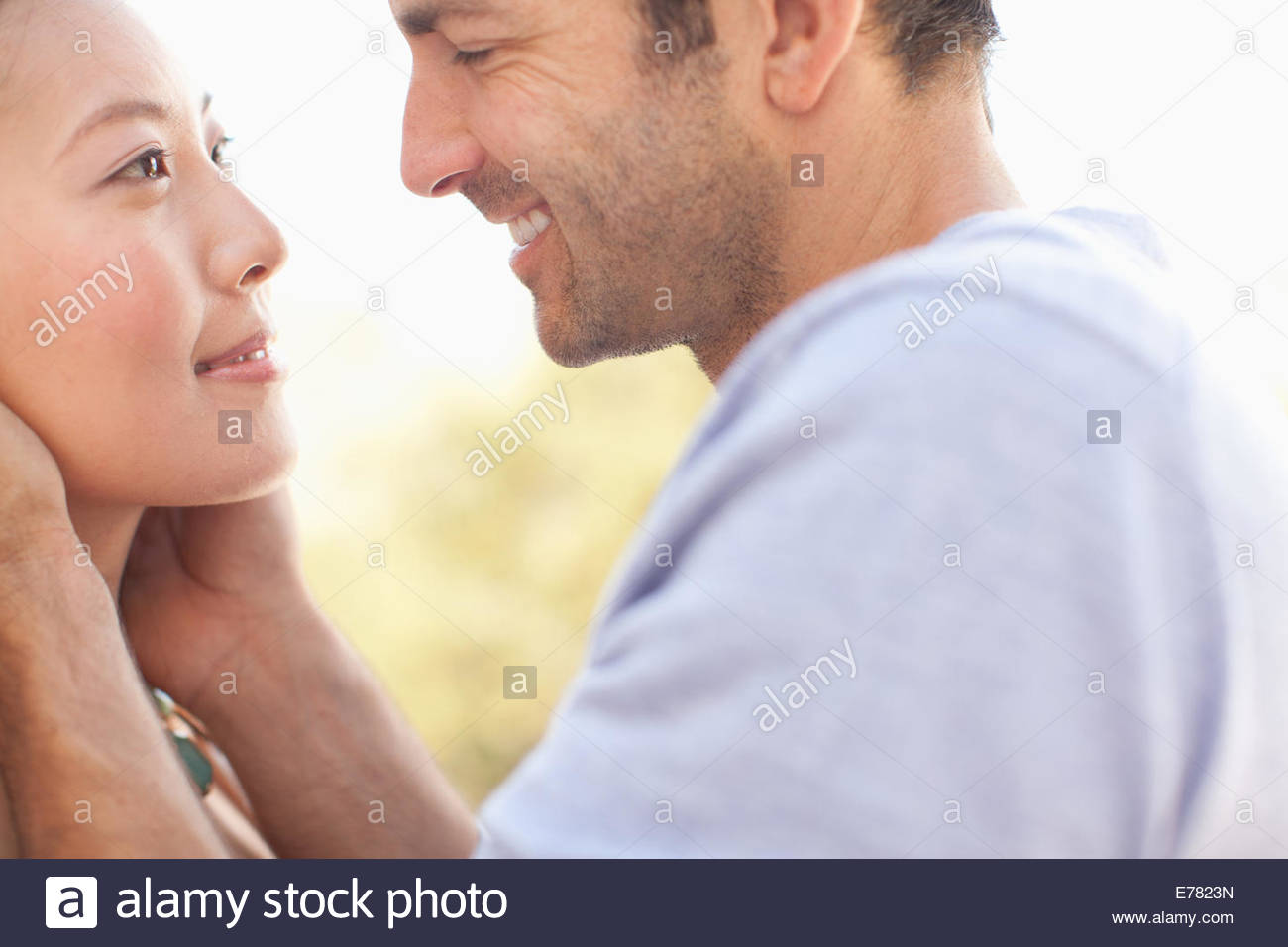 Close up of smiling coupleÂ's faces - Stock Image