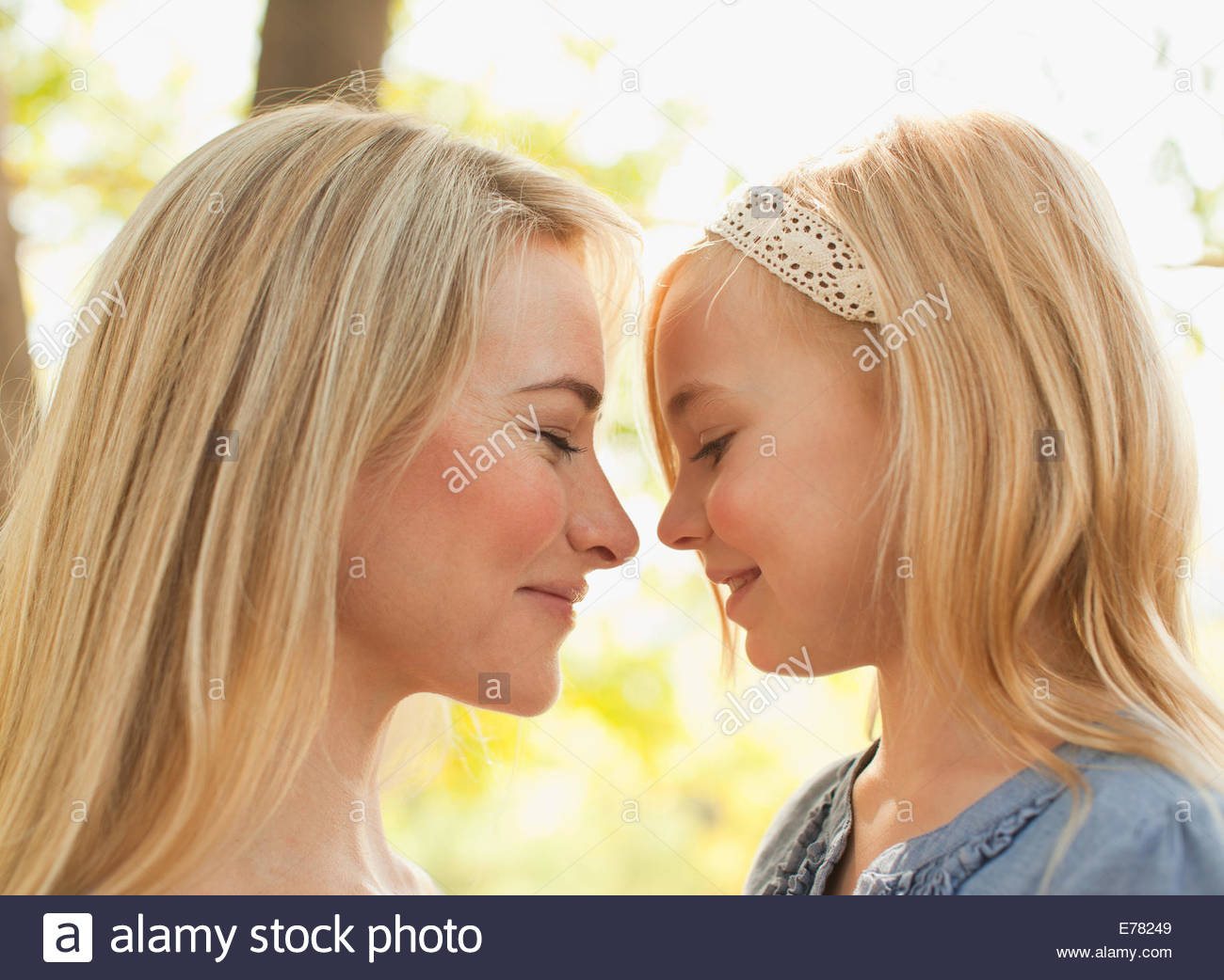 Mother and daughter laughing together - Stock Image