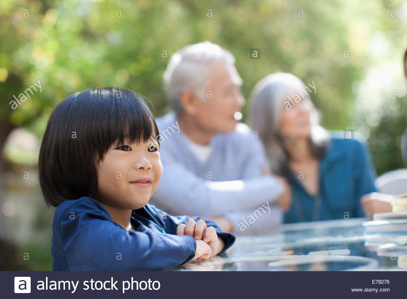 Smiling boy standing outdoors - Stock Image
