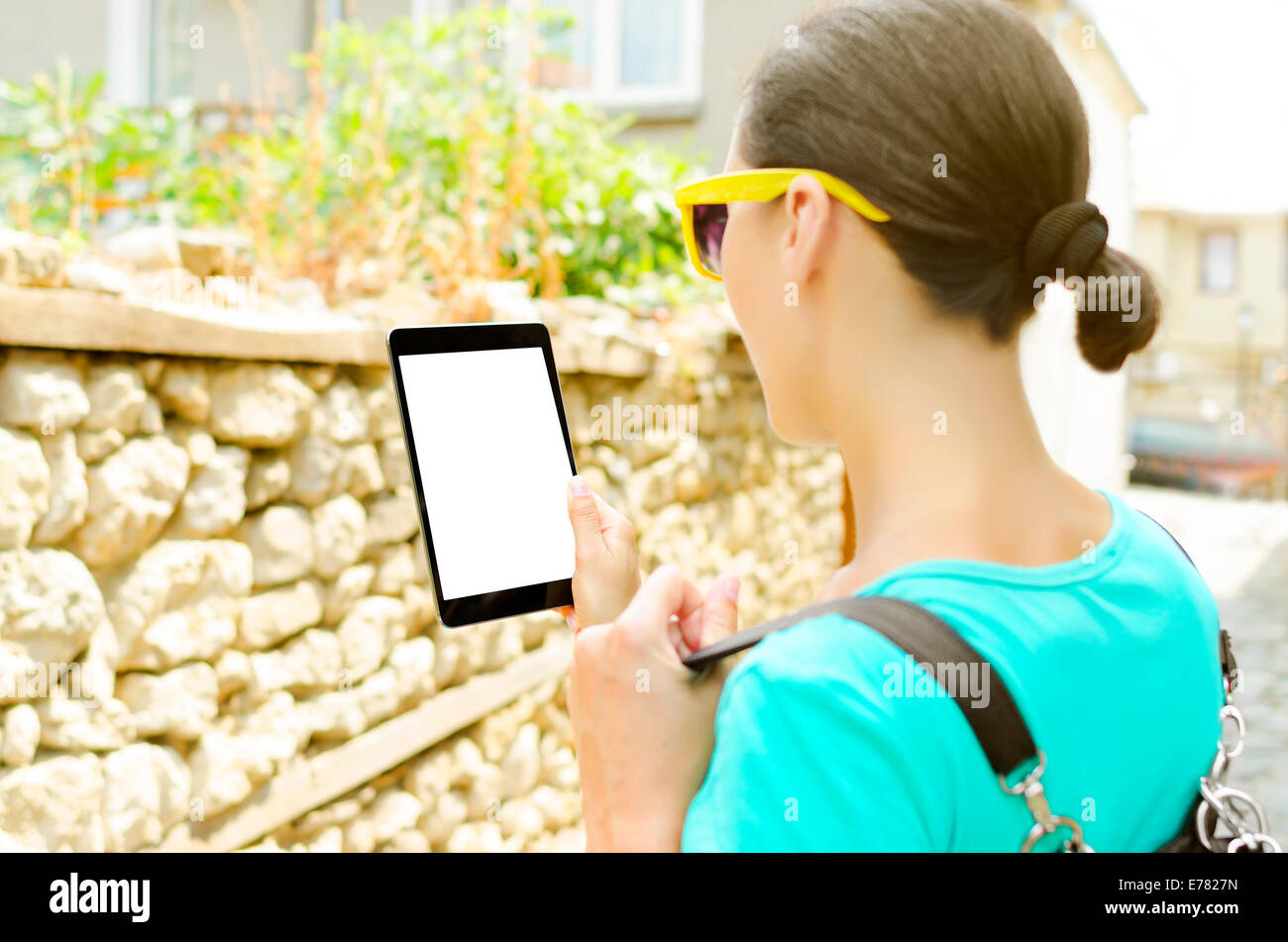 Tourist on the street holds tablet computer. Focus on tablet pc Stock Photo
