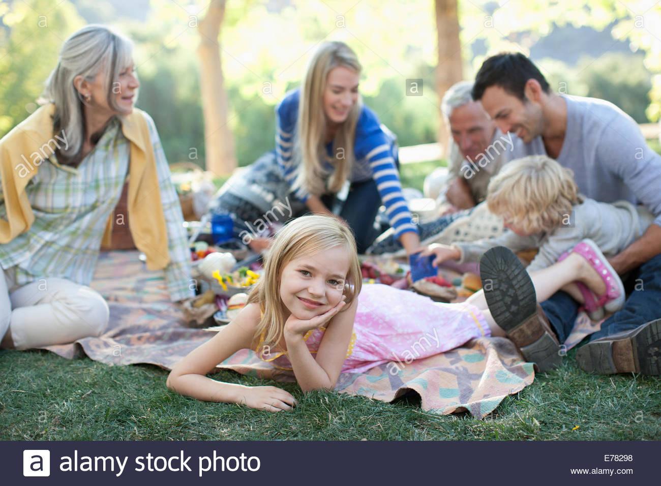Girl relaxing on blanket outdoors - Stock Image