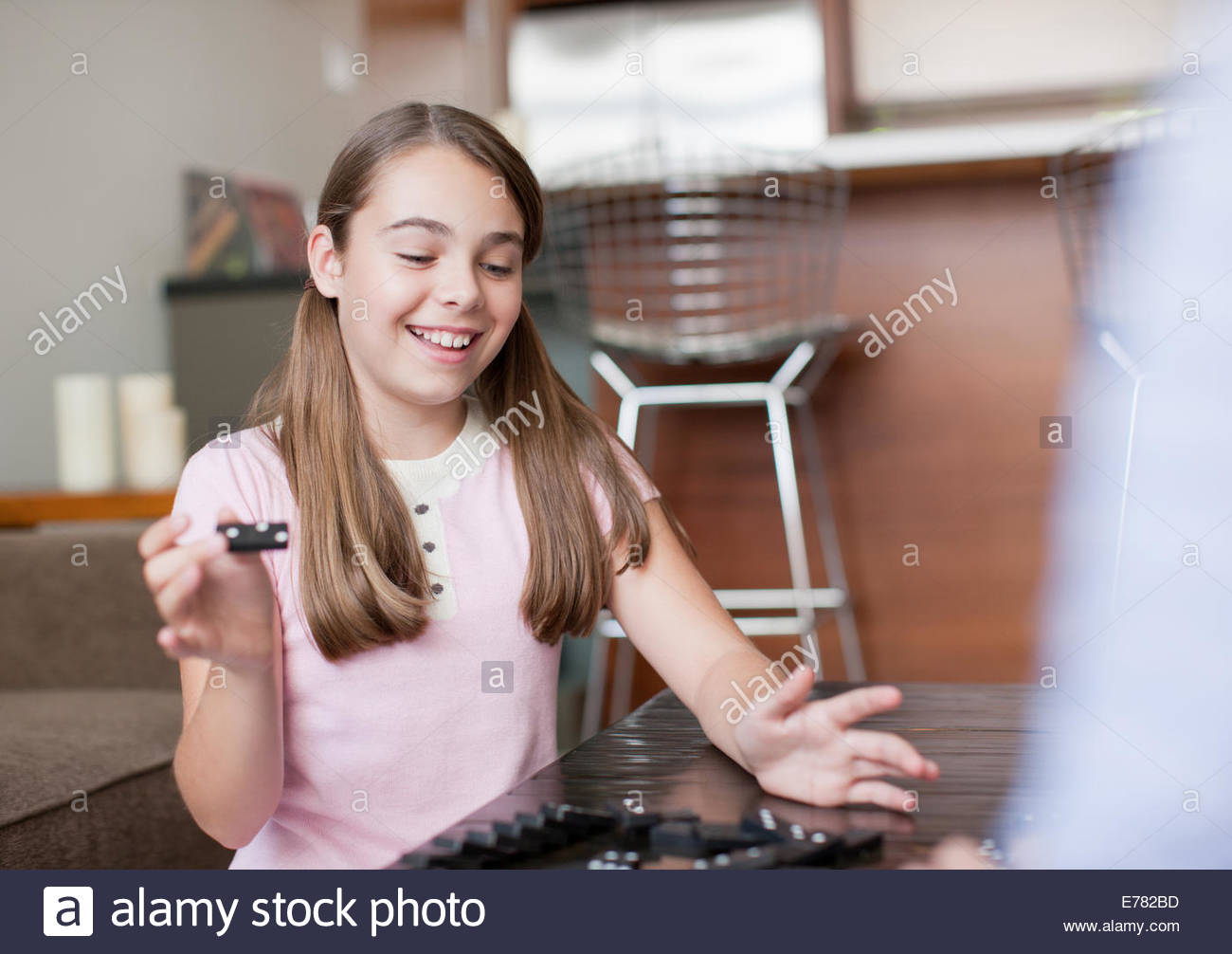 Mother and daughter playing dominoes - Stock Image