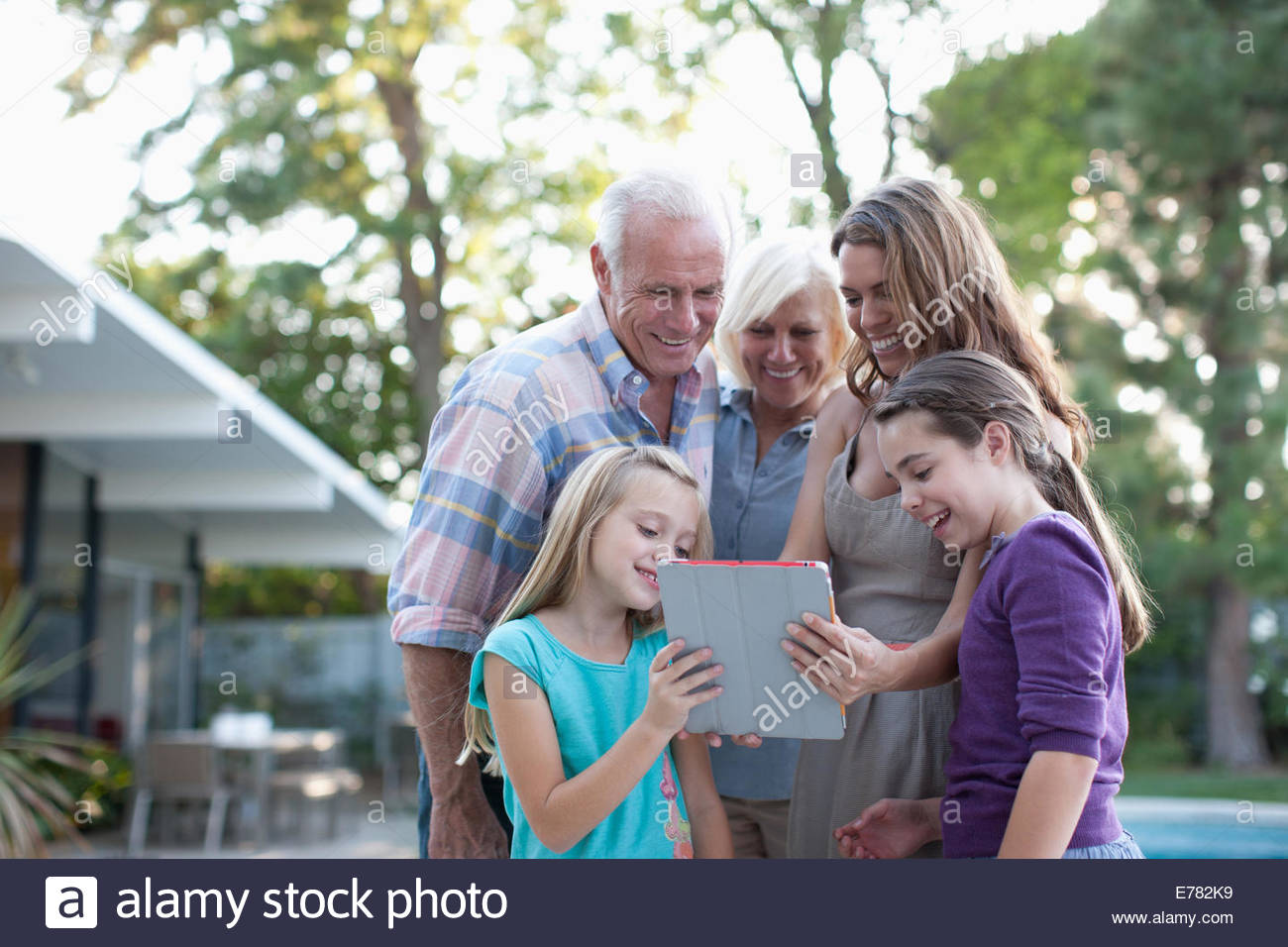 Extended family outdoors - Stock Image