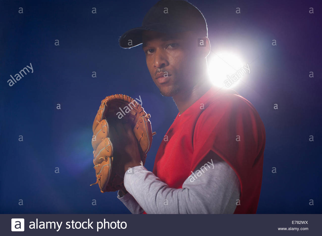 Baseball player holding glove - Stock Image