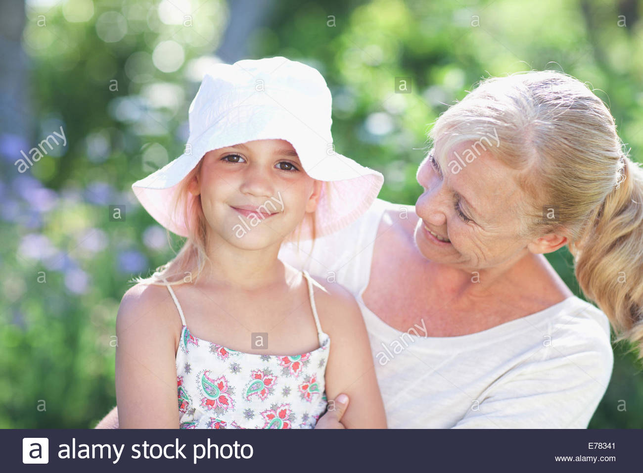 Grandmother and granddaughter outdoors - Stock Image