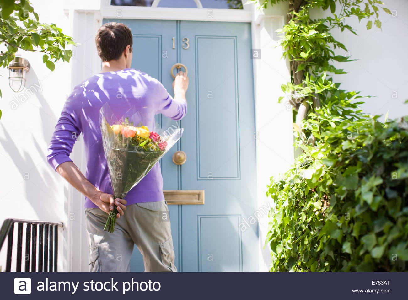 Man Holding Bouquet Flowers Knocking Stock Photos & Man Holding ...