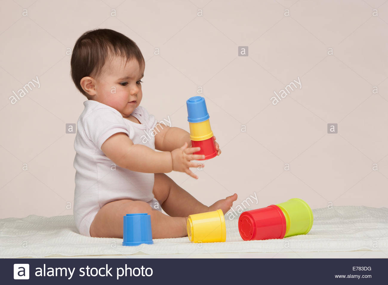 A baby playing with building toys - Stock Image