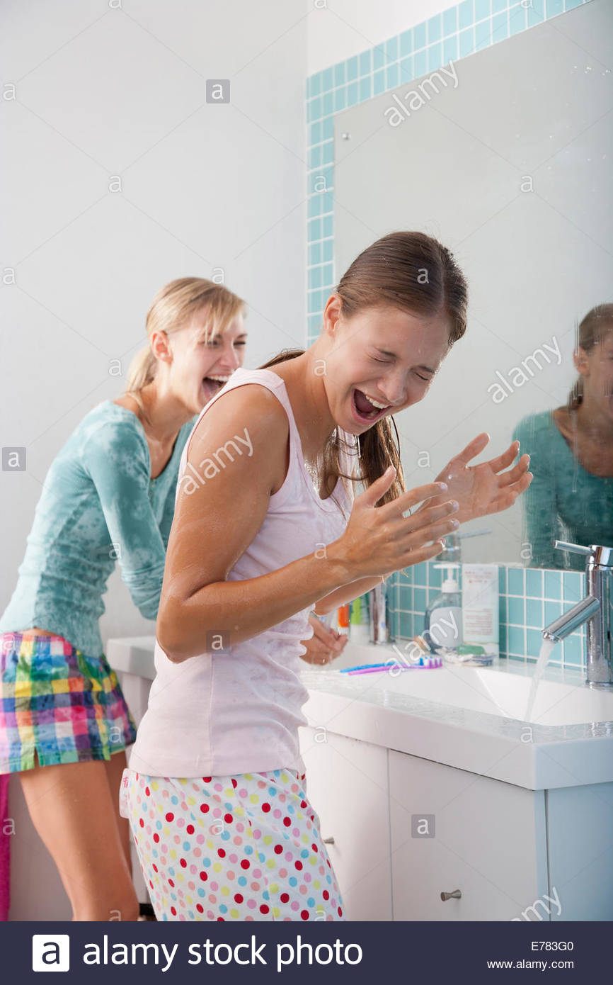 Two girlfriends in a bathroom - Stock Image
