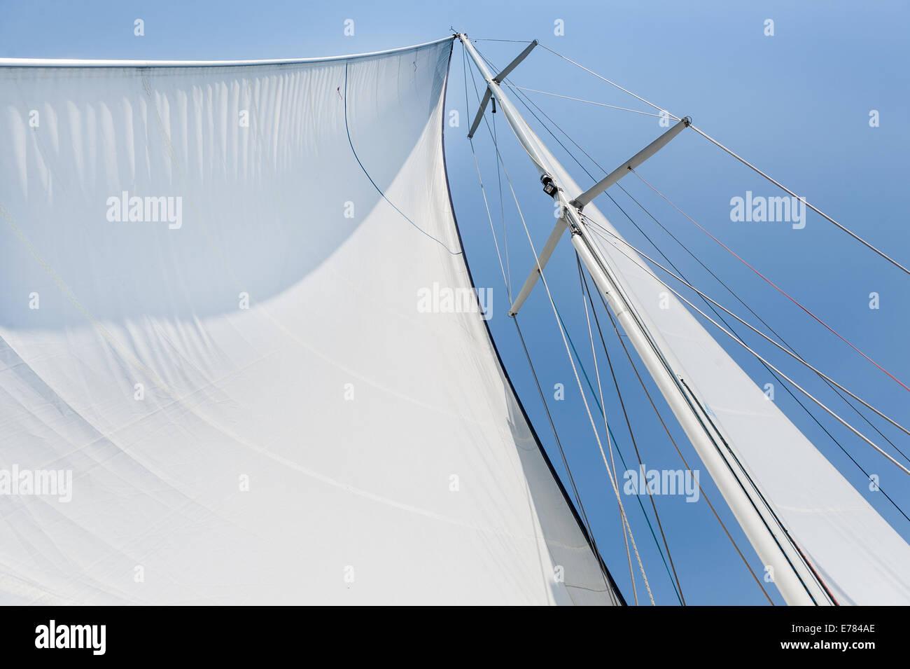 Big white sail hoisted - Stock Image