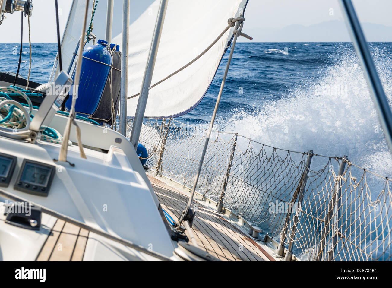 Fast sailing cruising yacht at heeling - Stock Image