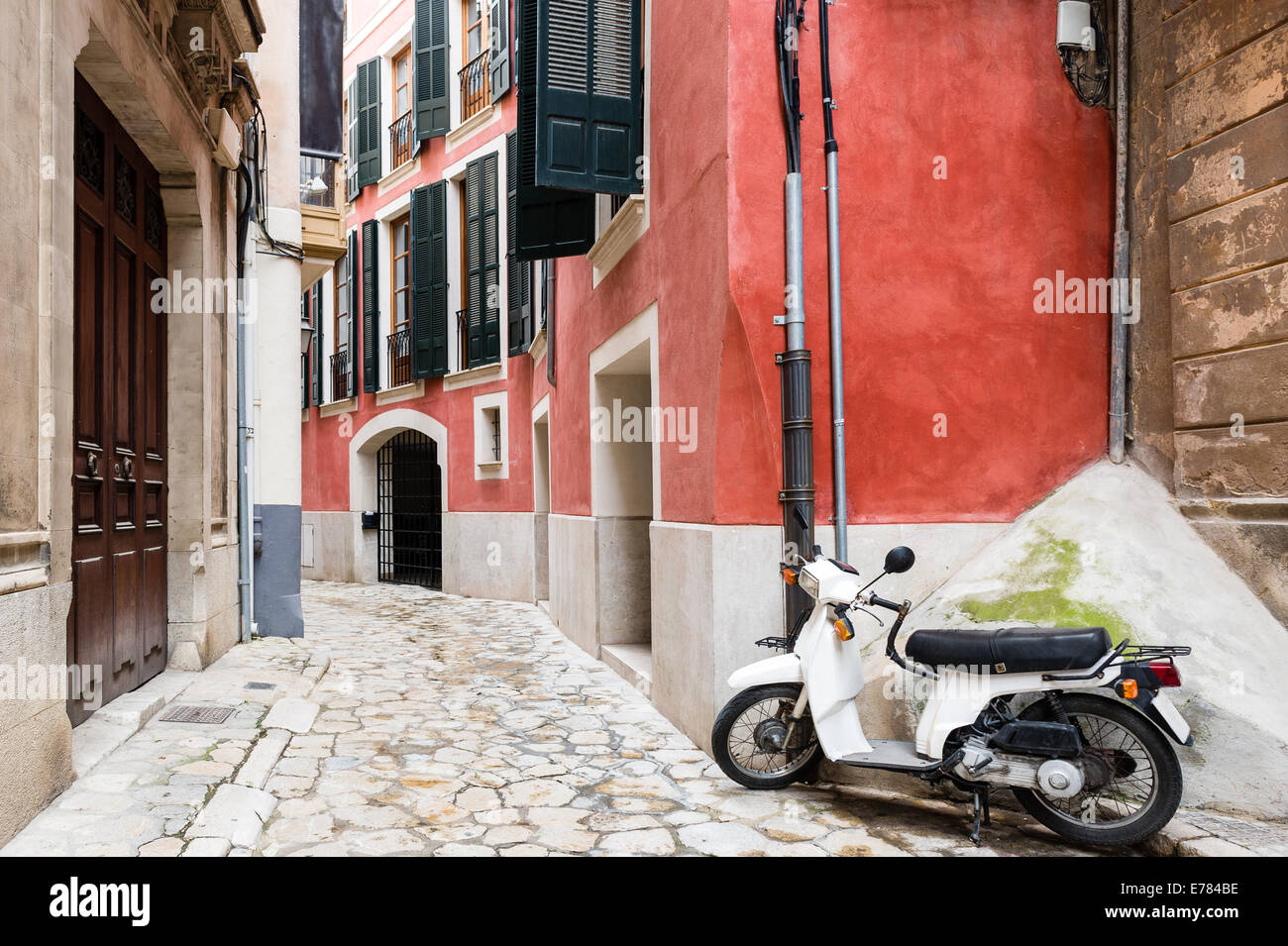 Colorful narrow street in old mediterranean town - Stock Image