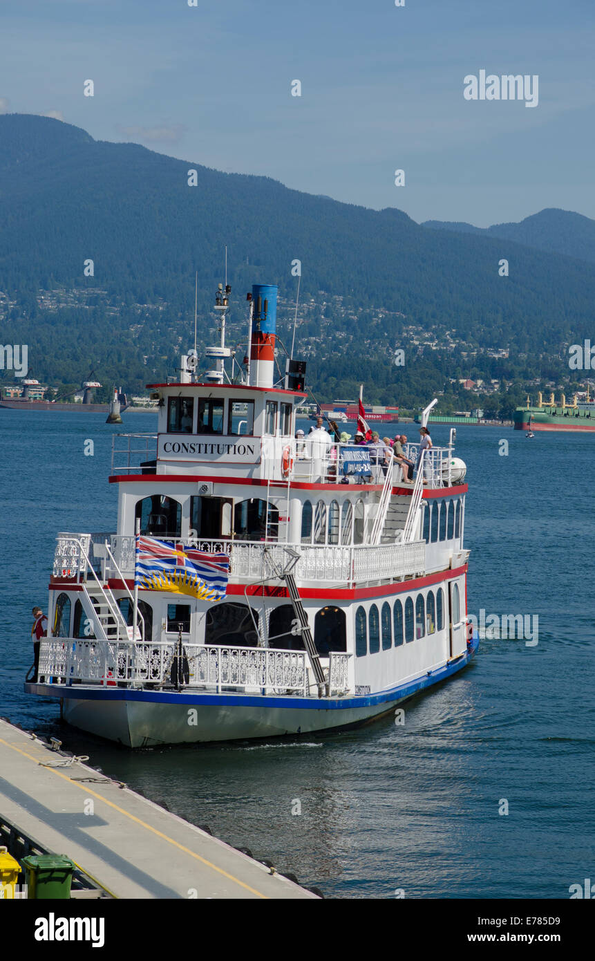 Harbour tour boat docking, Vancouver, Canada - Stock Image