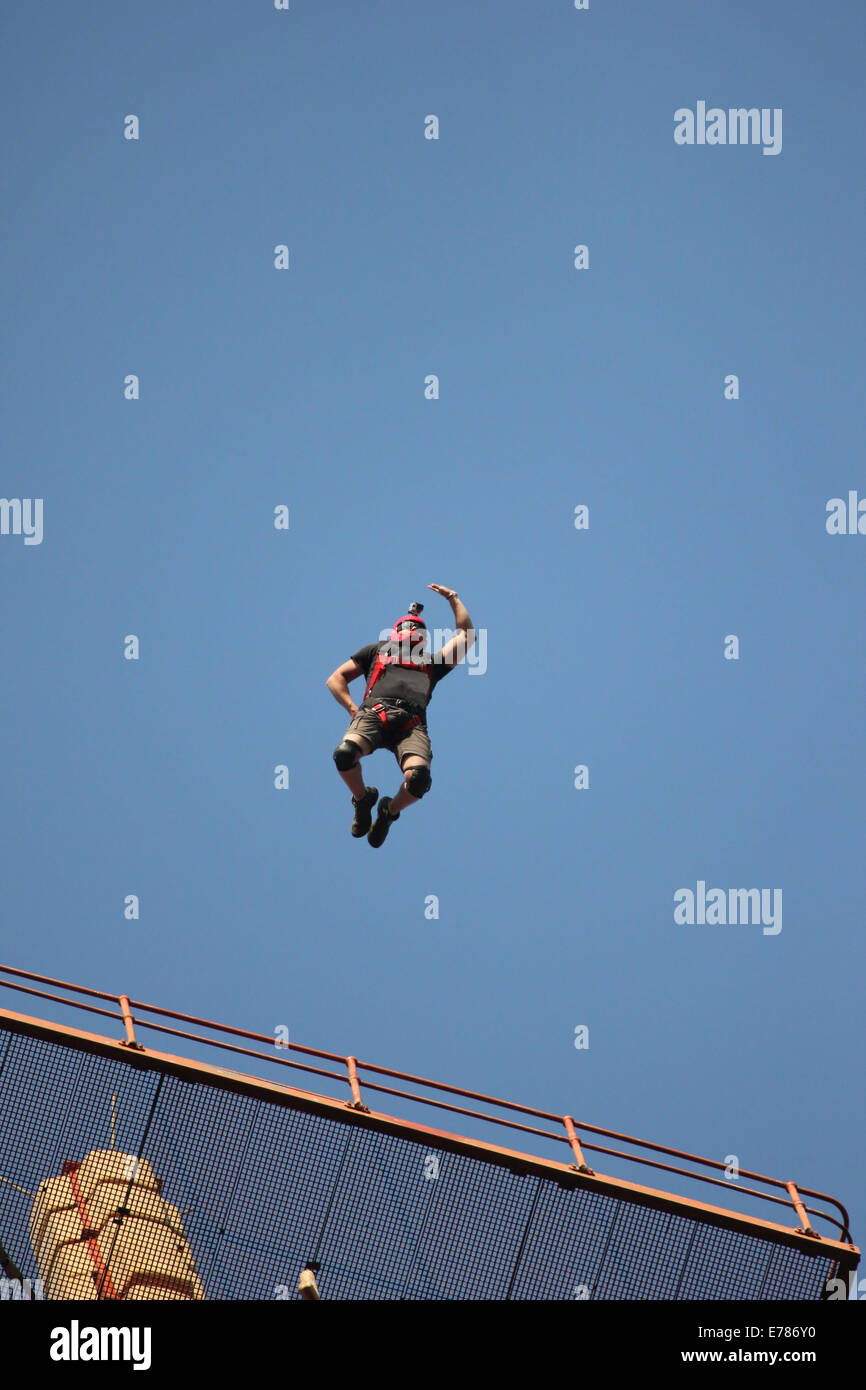 Basejumper jumps off antenna - Stock Image