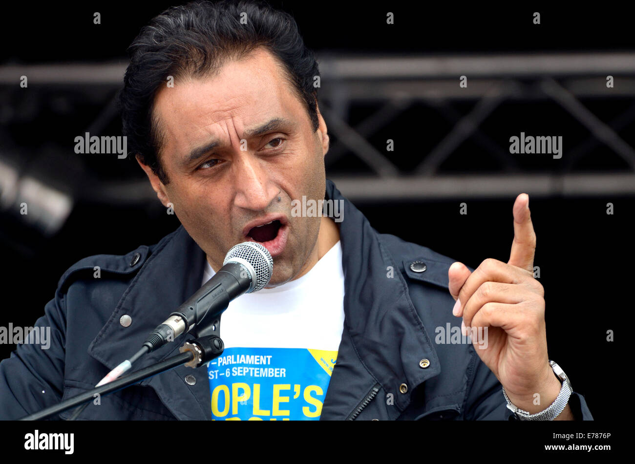 Dr Onkar Sahota (practising GP and member of the London Assembly for Ealing and Hillingdon) speaking at a rally - Stock Image