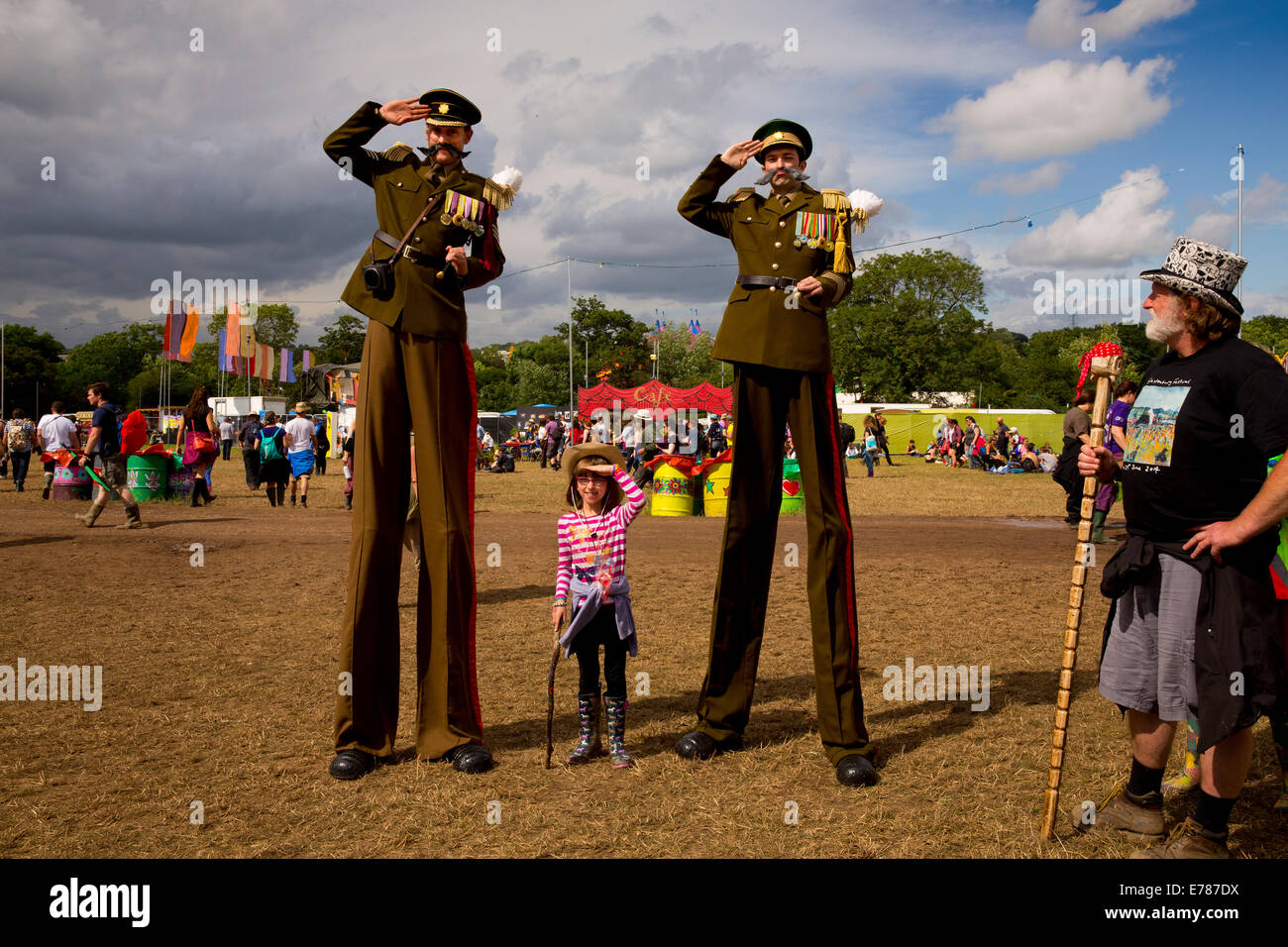 Photo op with soldiers on stilts, Glastonbury Festival 2014 - Stock Image