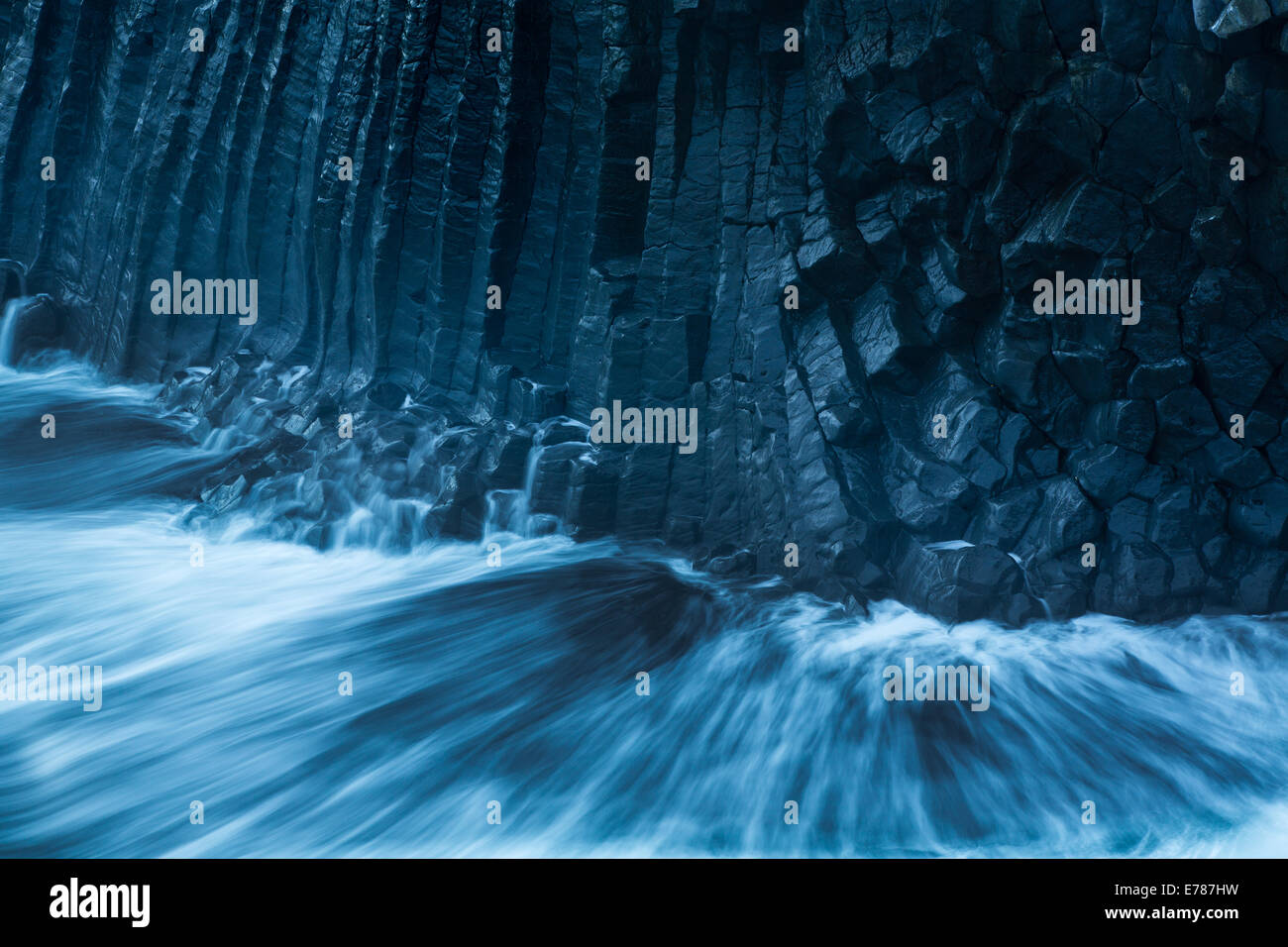 the cliffs and basalt rocks streaked with the guano of kittiwakes, nr Arnastapi, Snaefellsnes Peninsula, western - Stock Image