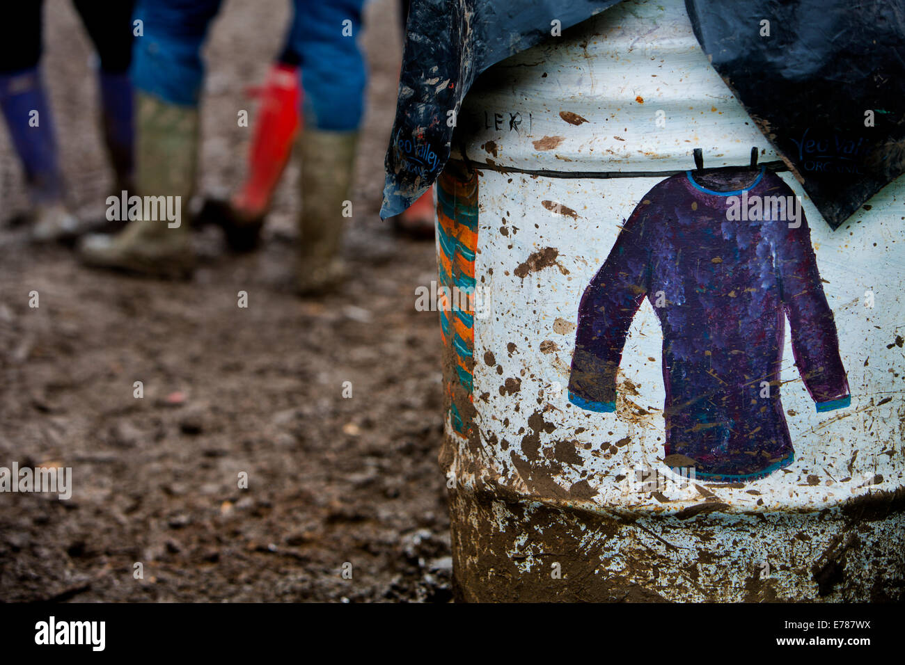 Rubbish collected daily from one of the 15,000 colourful oil drums dotted around the Glastonbury Festival site 2014 - Stock Image