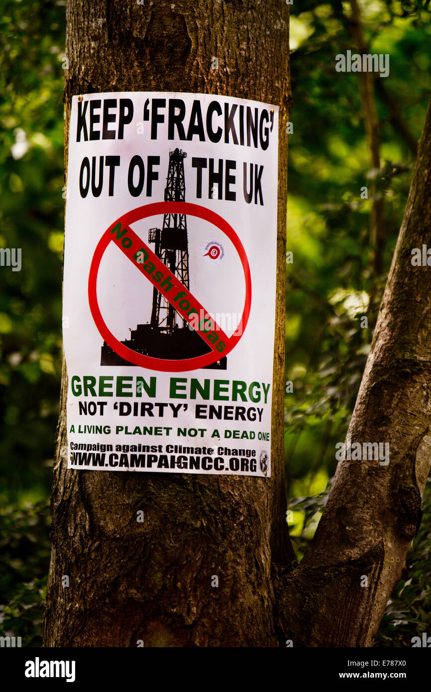 Anti fracking poster on a tree in Glastonbury. Glastonbury Festival 2014 - Stock Image