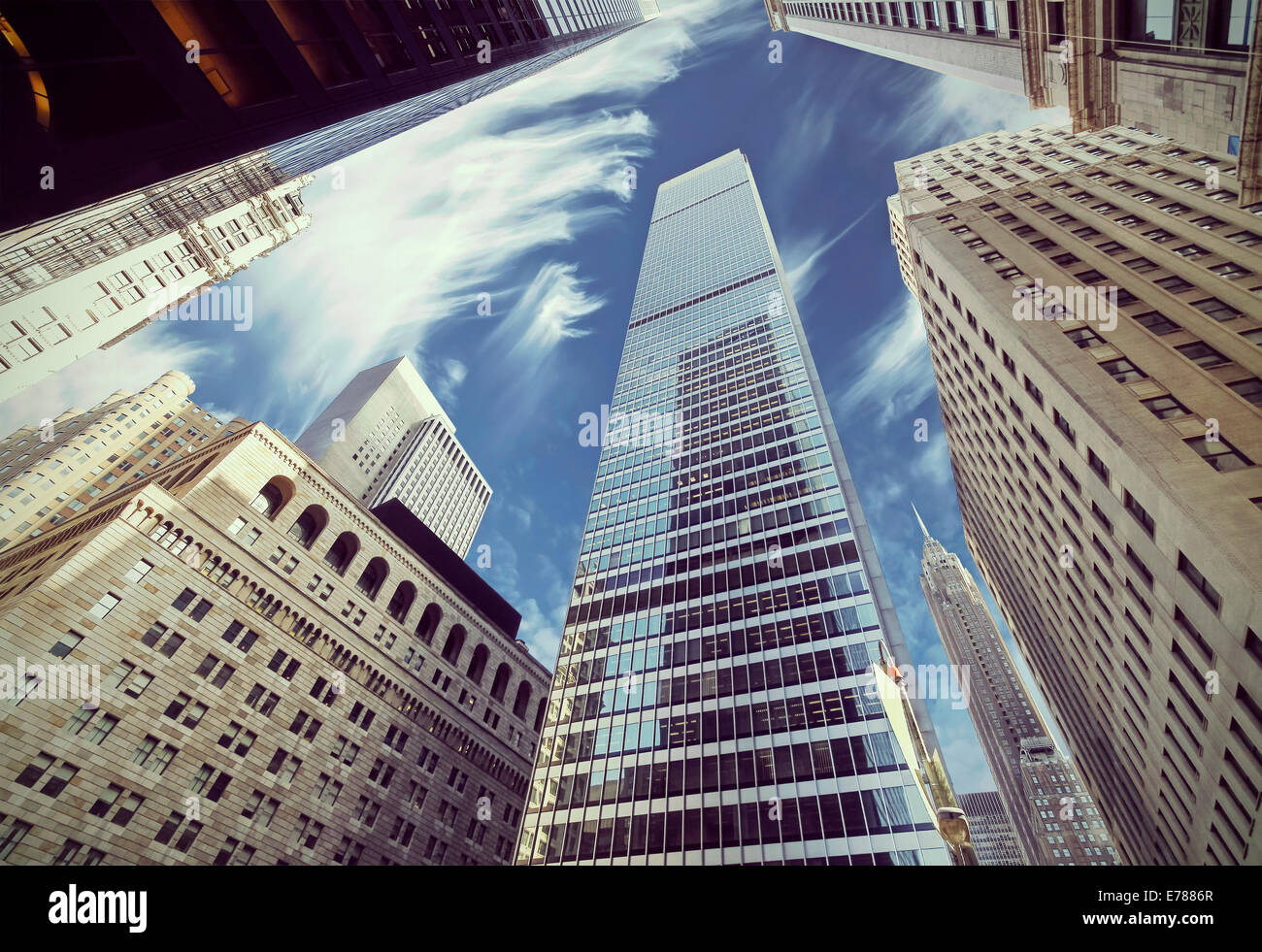 Retro filtered view of skyscrapers in Lower Manhattan, looking up at sky, New York City. - Stock Image