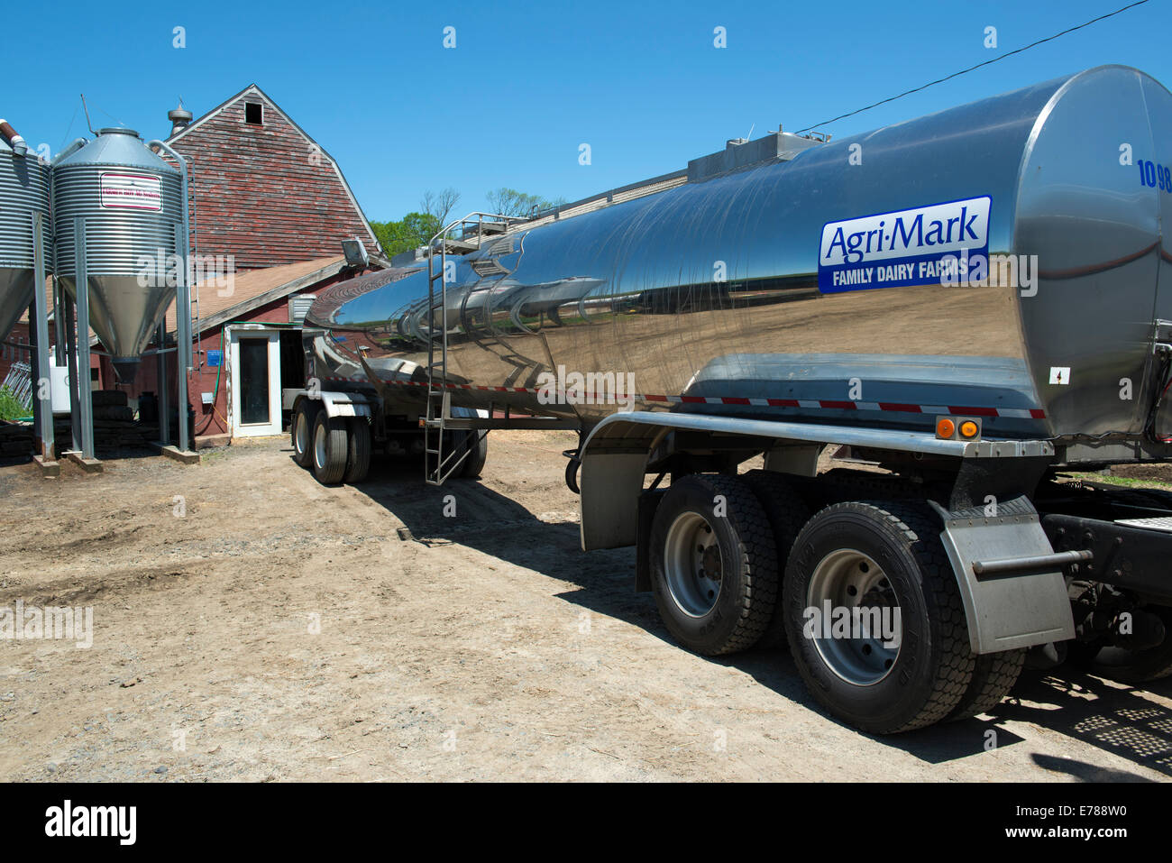 Tank or tanker truck visits dairy farm collecting milk for Agri-Mark cooperative.  Woodbury, CT. - Stock Image