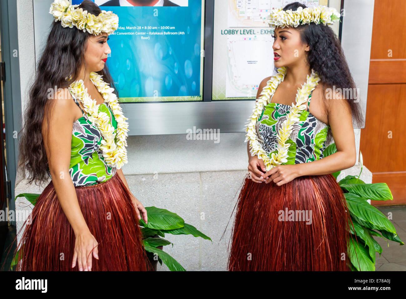 Honolulu Hawaii Hawaiian Oahu Convention Center centre inside interior hula dancers greeter grass skirt flower lei - Stock Image
