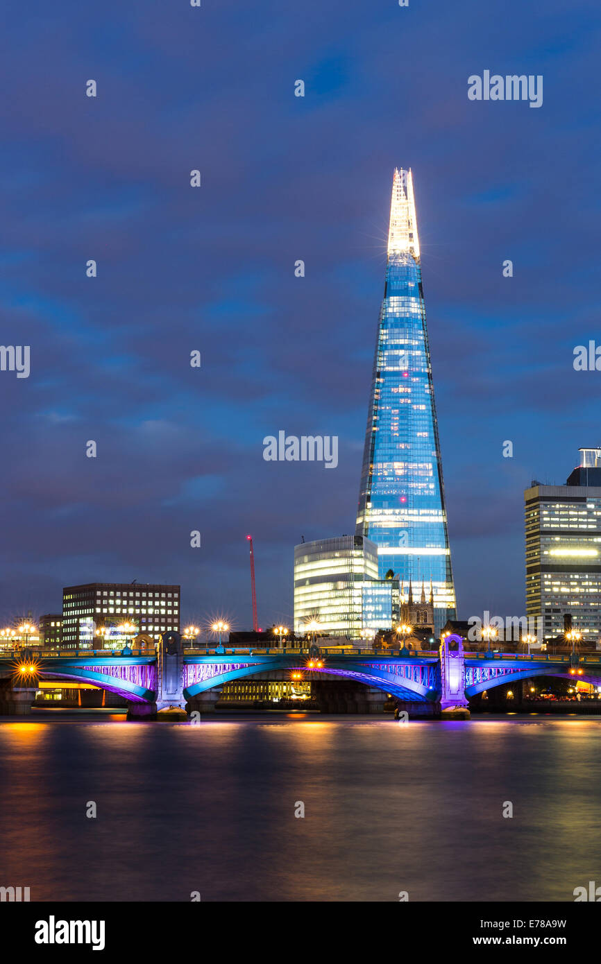 A long exposure night scene of the Shard and Southwark Bridge along the river Thames in London, England - Stock Image