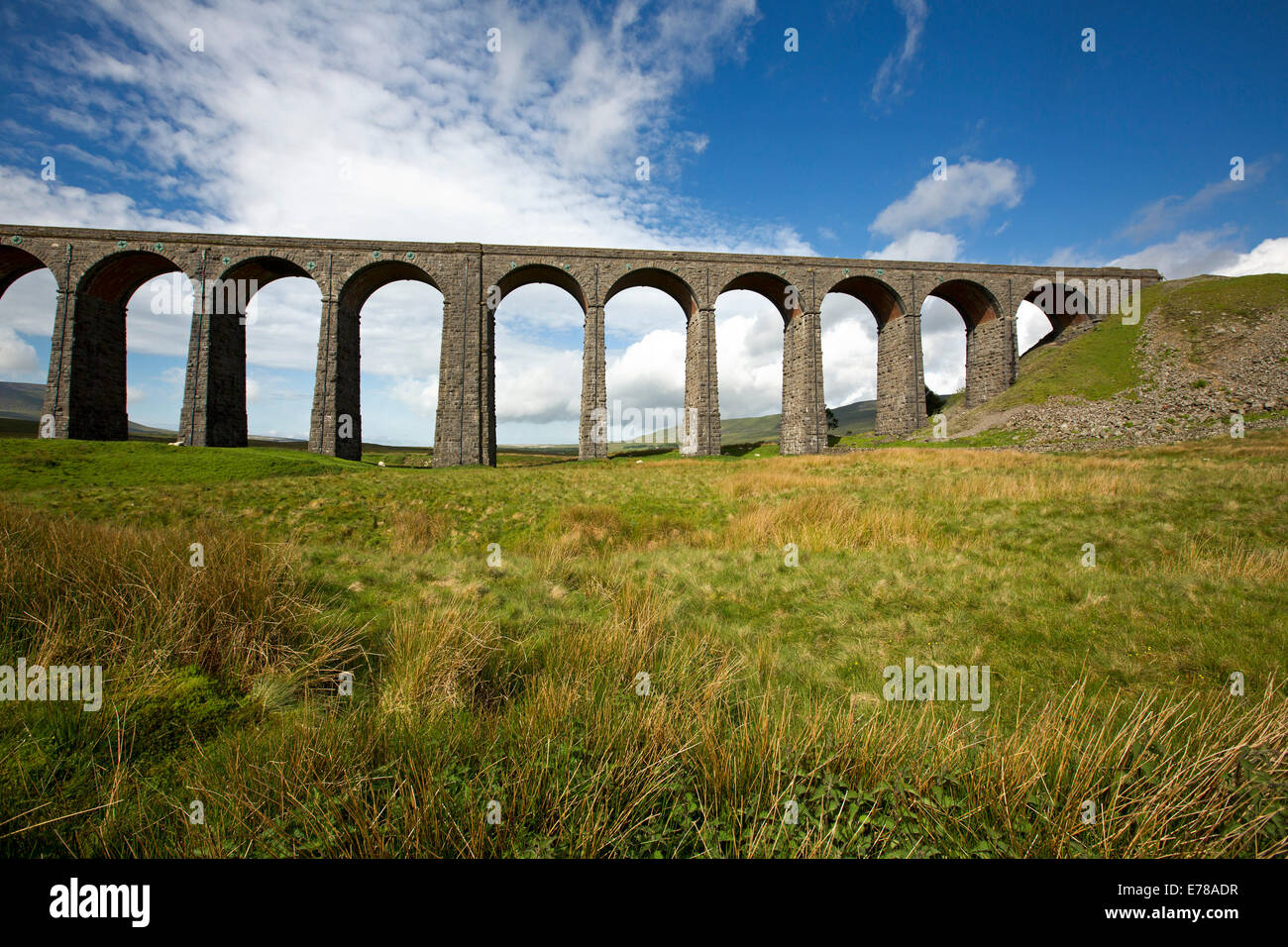 Ribblehead viaduct, massive 19th century British rail bridge crossing Ribble Valley and under blue sky in North - Stock Image