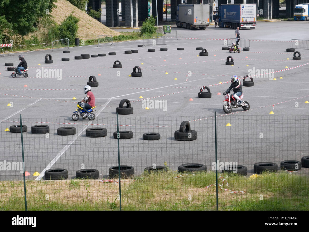 minibikes in parking lot, Italy - Stock Image