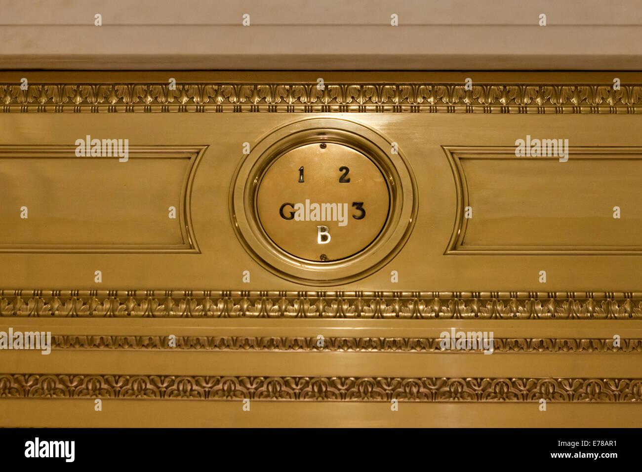 A vintage elevator floor level indicator at basement level - USA - Stock Image