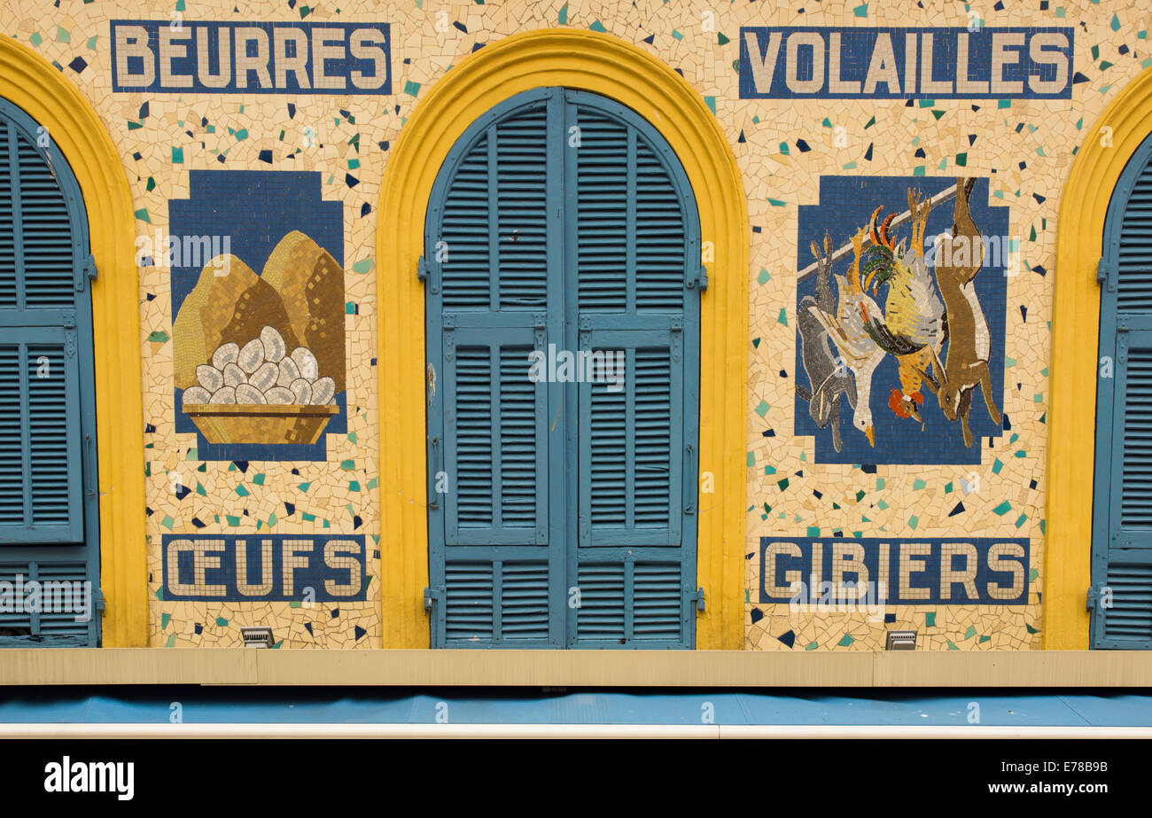 Old tiled signs in French for poultry, eggs, butter and game. - Stock Image