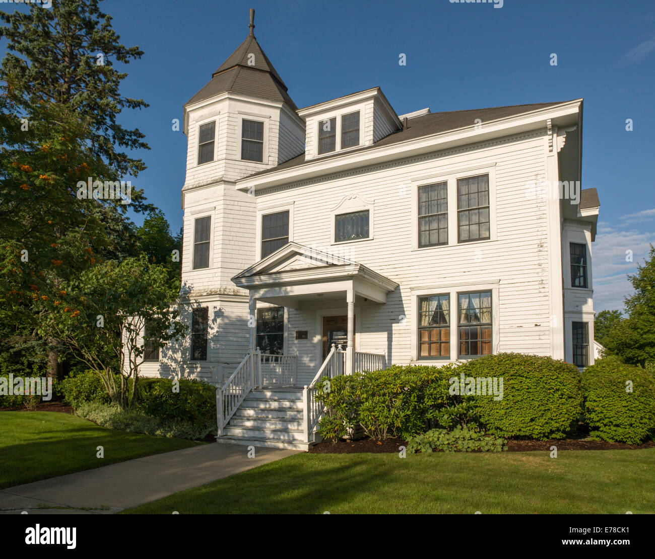 Traditional Victorian style home in New England with turret and gable. - Stock Image