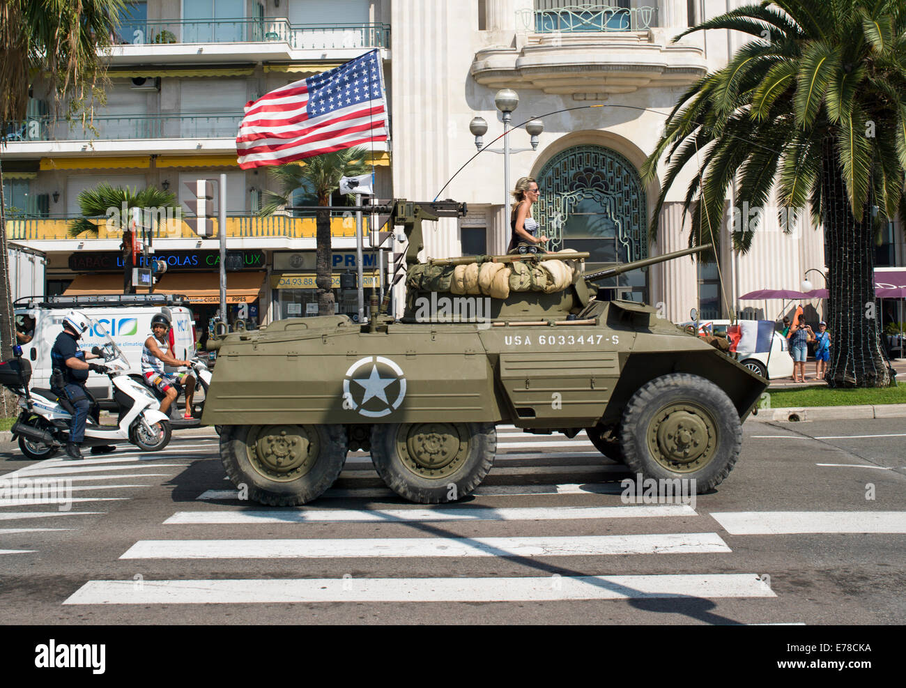 Military armored personnel carrier in a parade commemorating the liberation of Southern France during World War - Stock Image