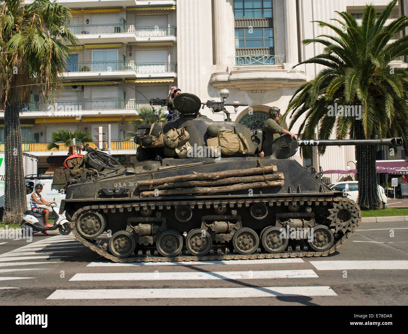 World War II tanks on parade during a commemoration of the Allied liberation of southern France. - Stock Image