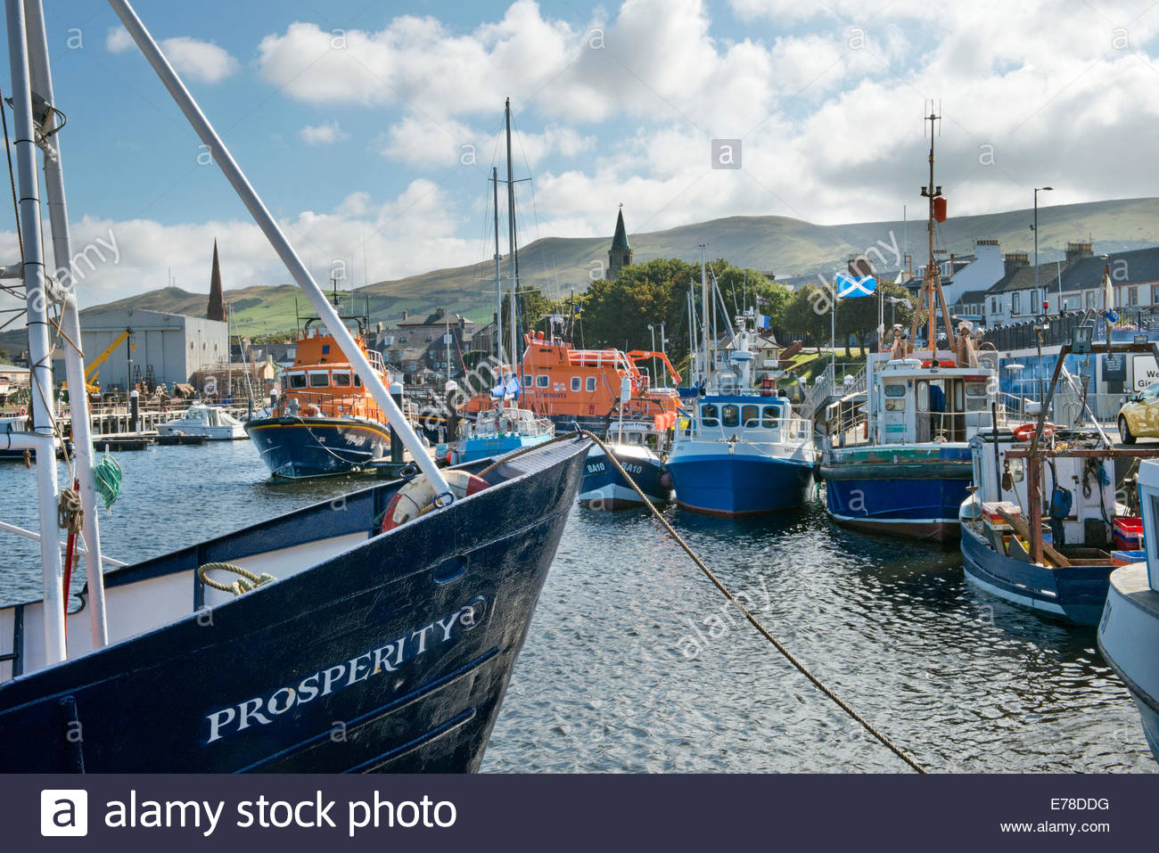 Fishing trawler 'Prosperity' tied up at Girvan Harbour, Ayrshire, Scotland with the Scottish Saltire flag - Stock Image