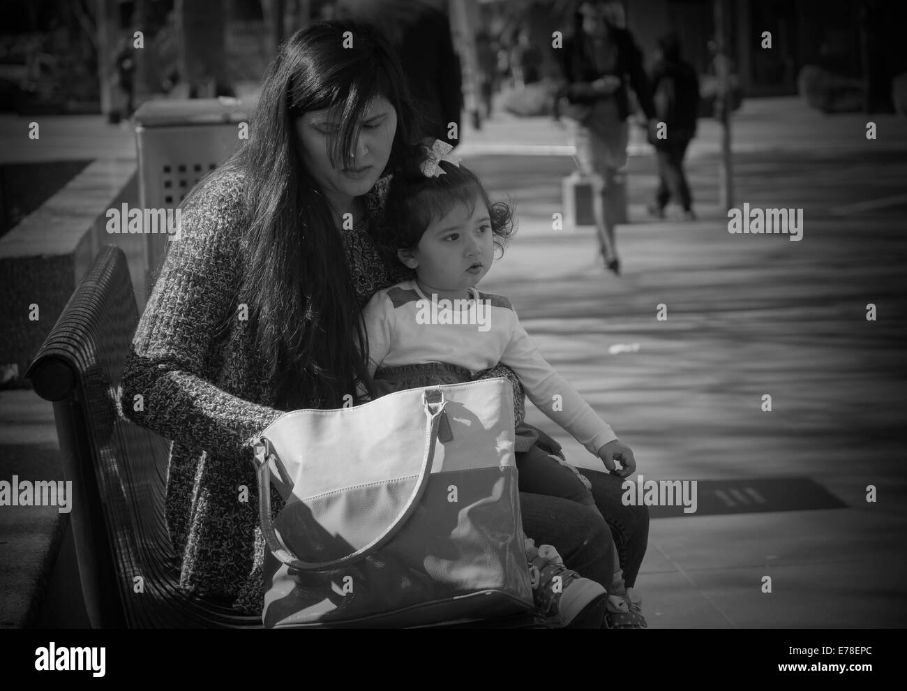 Young Indian Mother With Cute Toddler Girl Sitting On Her Lap Stock Photo