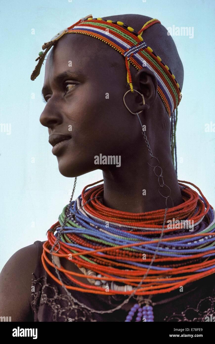 El Molo mother with jewelry, El Molo Tribe, Lake Turkana - Kenya. - Stock Image