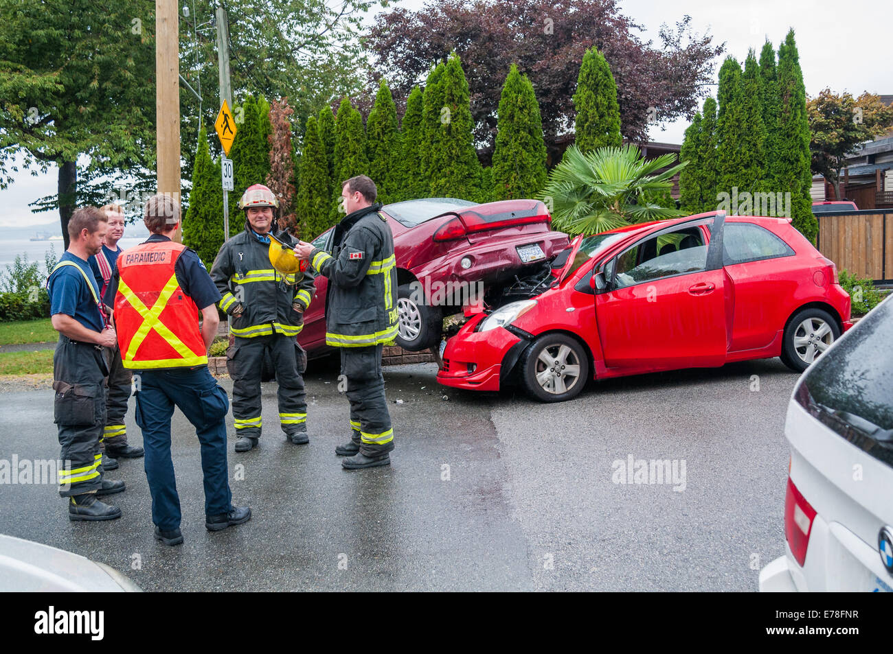 Firemen attend car accident - Stock Image