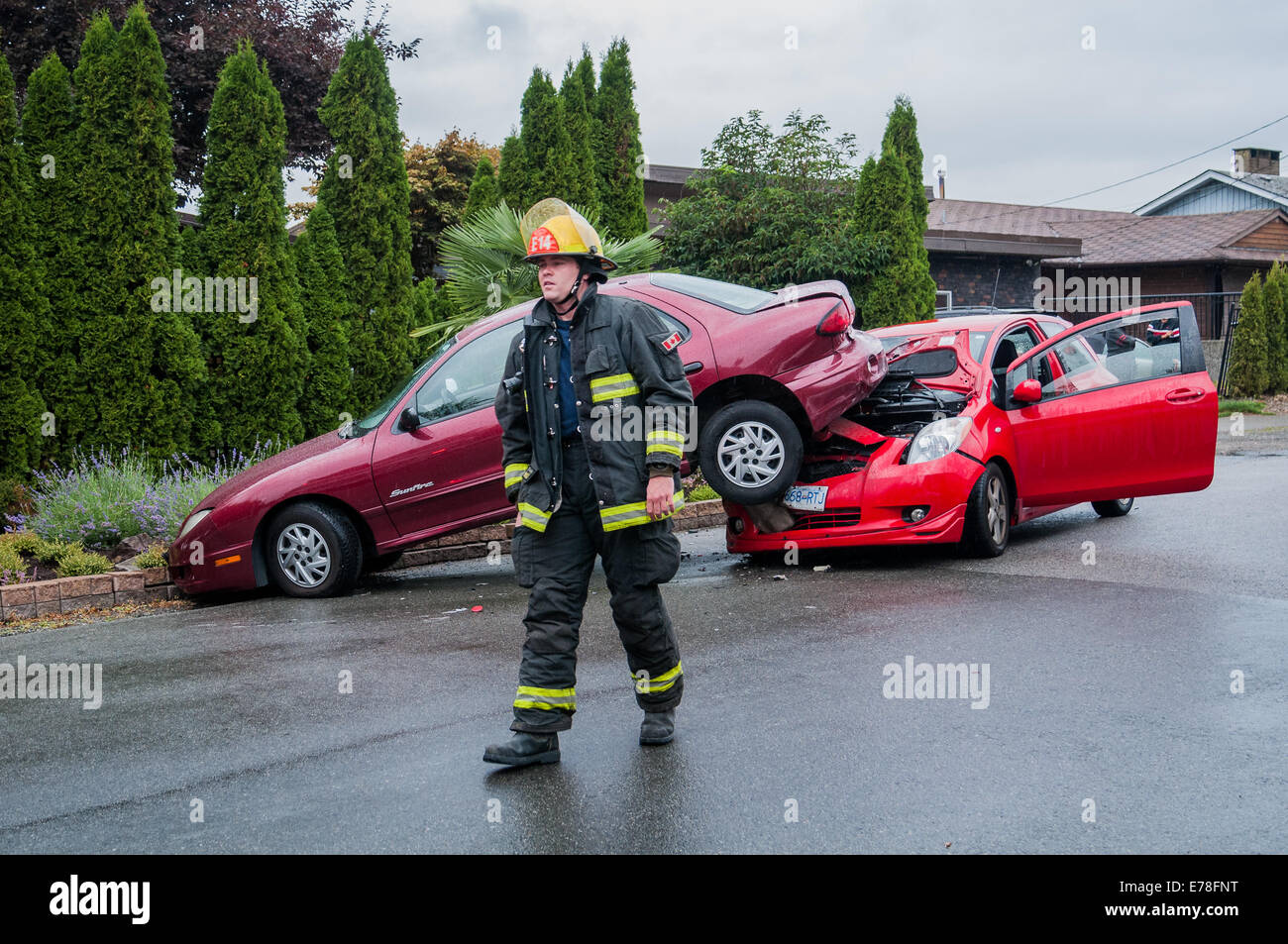Firemen at  car accident scene. - Stock Image