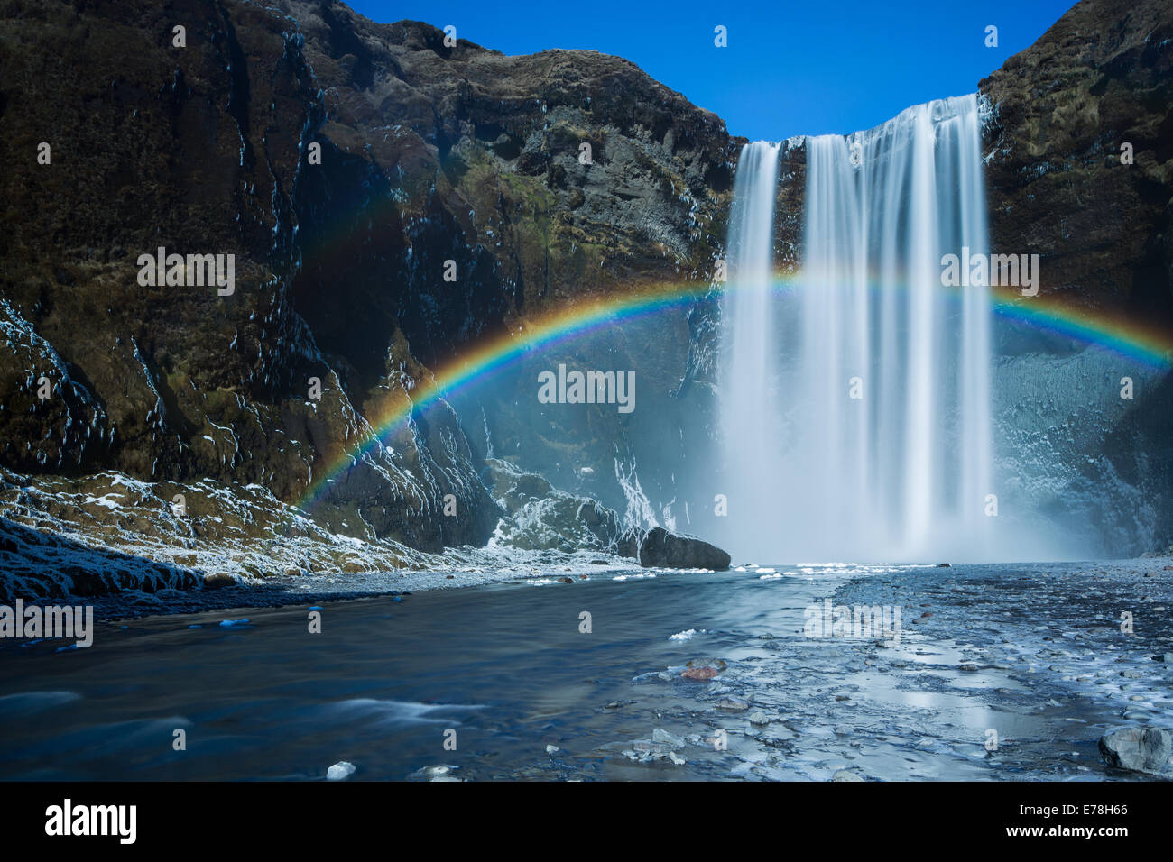 a rainbow at Skógafoss, southern Iceland - Stock Image