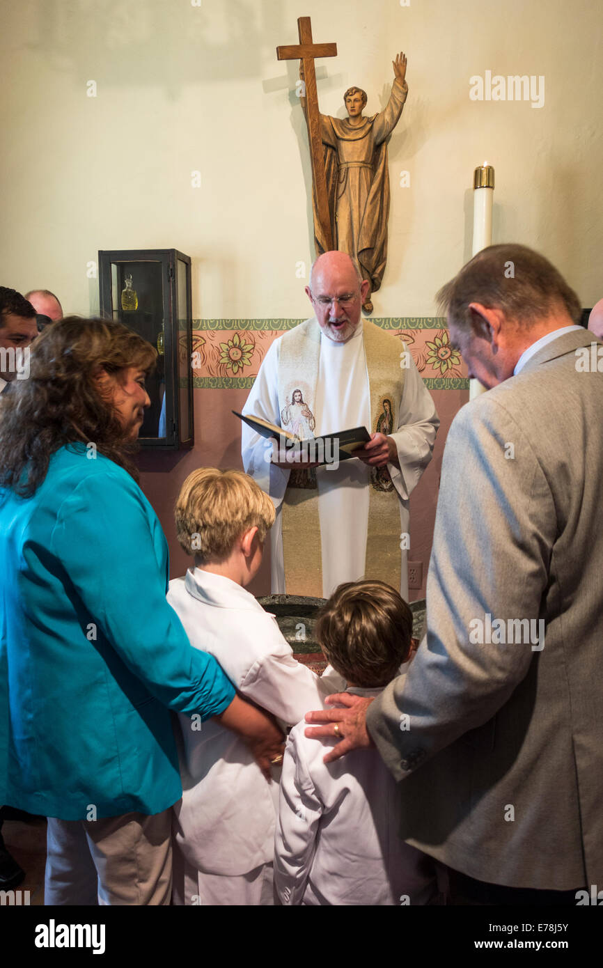 baptism ceremony inside old historic Mission San Buenventura; Ventura; California, USA - Stock Image