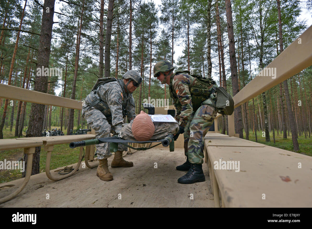 A U.S. Soldier, left, and a Macedonian soldier practice the evacuation of simulated casualties during the standardization - Stock Image