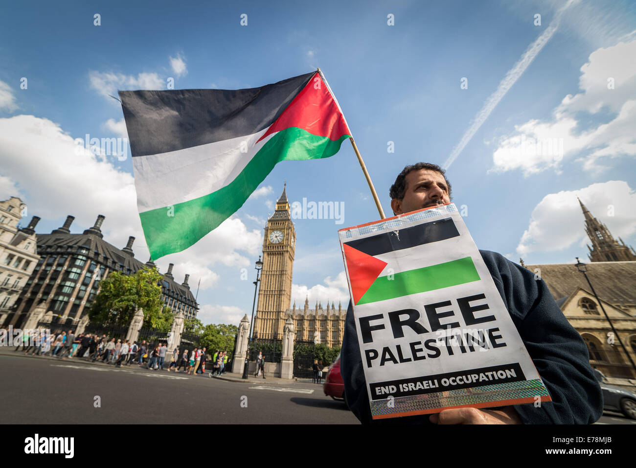 London, UK. 9th Sept, 2014. 'Free Palestine' protester outside Parliament 2014 Credit:  Guy Corbishley/Alamy Live - Stock Image
