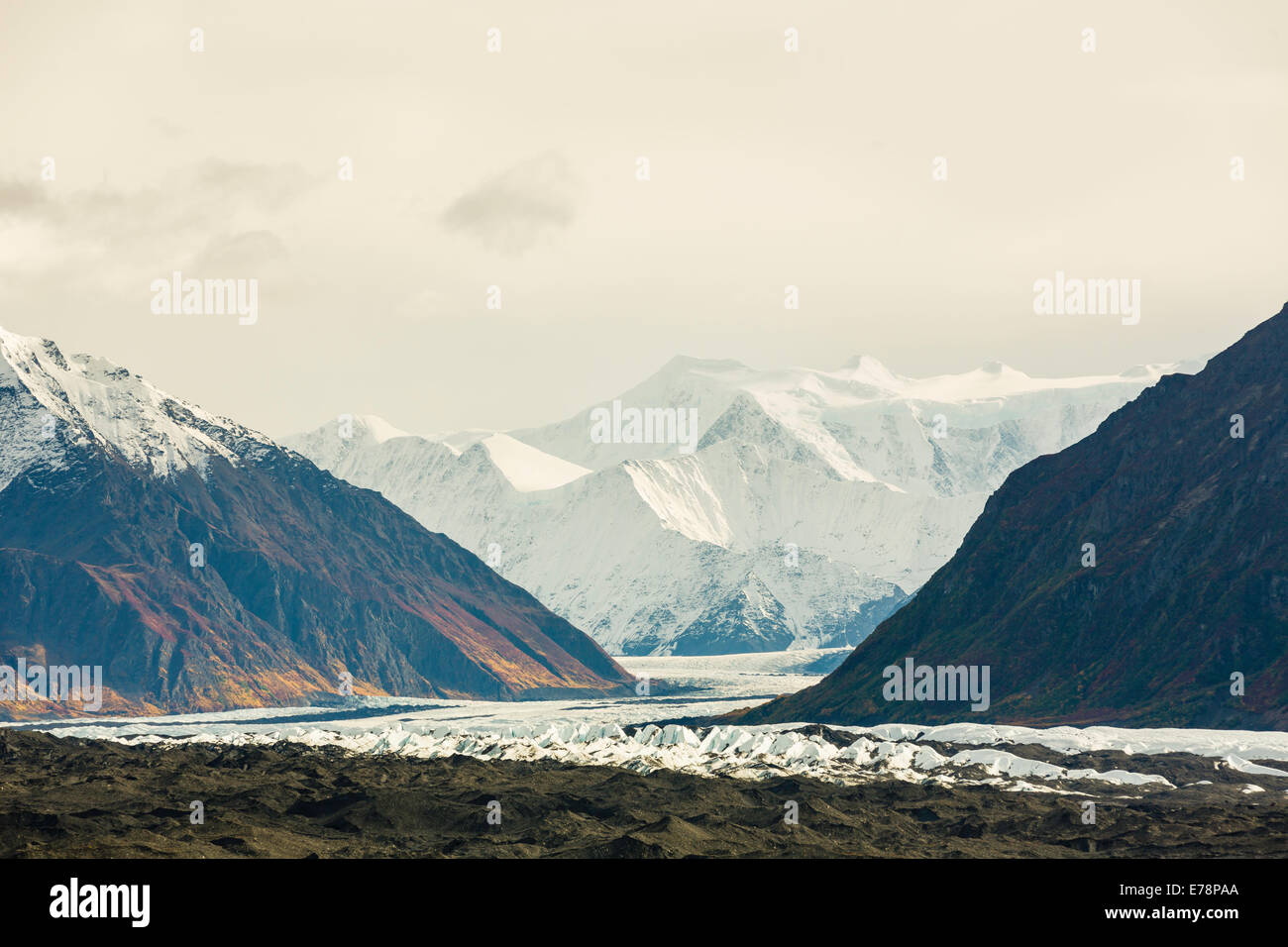 The Matanuska Glacier winds its way down the Chugach  Mountains of Southcentral Alaska in autumn. - Stock Image